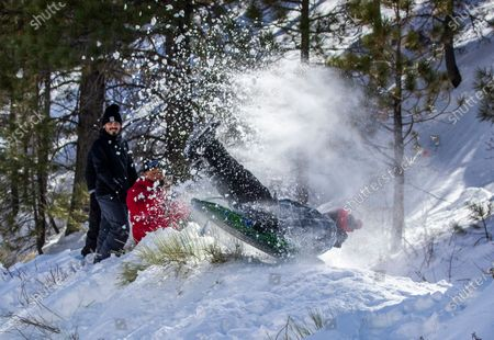 Stock Picture of WRIGHTWOOD, CA - With his family watching, Edgar Gomez, of Inglewood, soars off a makeshift snow jump thanks to snow from recent storms and more is forecasted to arrive in the San Gabriel Mountains near Wrightwood Wednesday, Jan. 27, 2021. (Allen J. Schaben / Los Angeles Times)