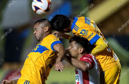 Stock Picture of Tigres UANL players Rafael de Souza (L) and Diego Reyes (R) in action against Martin Barragan (C) of Club Necaxa during the Clausura Tournament soccer match between Tigres UANL and Club Necaxa at Universitario Stadium in San Nicolas de los Garza, Mexico, 28 January 2021.