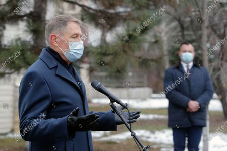 Romania's President Klaus Iohannis gestures during a press statement at the 'Matei Bals' Covid-19 hospital in Bucharest, Romania, 29 January 2021. A fire broke out early this morning at a pavilion of the 'Matei Bals' Hospital in the Romanian capital. Five people have died and 11 are reported injured as a result of the fire at the Institute of Infectious Diseases 'Matei Bals' as 120 patients with COVID-19 were transferred to other hospitals.