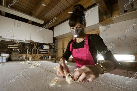 Spain's first female shaper and one of the few female surf craftswomen worldwide Marieta San Roman works at her studio 'La Mala Surfboards' in Los Angeles de San Rafael, a town in the province of Segovia, Castille and Leon region, central Spain, 29 January 2021. San Roman, born and bred in Segovia, some 400 kilometers from the nearest coast, says in an interview for Efe news agency that she 'wasn't sure the first board (she made) would float or not'.
