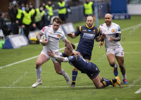 Stock Picture of Stuart Hogg of Exeter Chiefs breaking down the wing with the ball as he is tackled by Nick David of Worcester Warriors; Sixways Stadium, Worcester, Worcestershire, England; Premiership Rugby, Worcester Warriors versus Exeter Chiefs.
