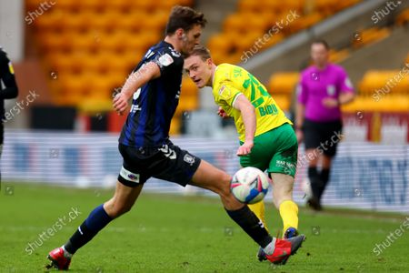 Stock Photo of Oliver Skipp of Norwich City performs a back heel pass around Dael Fry of Middlesbrough; Carrow Road, Norwich, Norfolk, England, English Football League Championship Football, Norwich versus Middlesbrough.