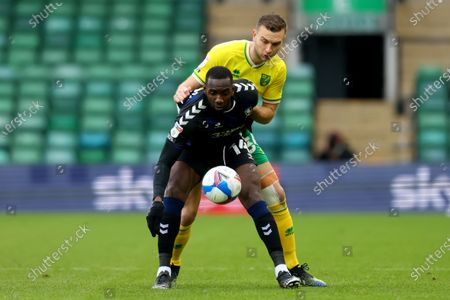 Yannick Bolasie of Middlesbrough under pressure from Ben Gibson of Norwich City; Carrow Road, Norwich, Norfolk, England, English Football League Championship Football, Norwich versus Middlesbrough.