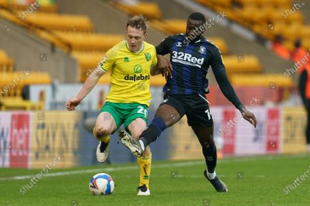 Oliver Skipp of Norwich City (20) and Yannick Bolasie of Middlesbrough (14)