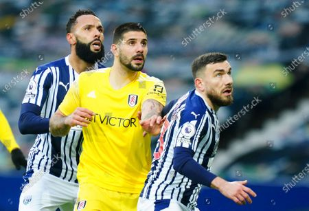 Aleksander Mitrovic of Fulham between Kyle Bartley and Robert Snodgrass of West Bromwich Albion