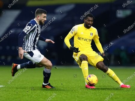 Andre-Frank Zambo Anguissa of Fulham and Robert Snodgrass of West Bromwich Albion