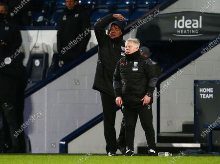 West Bromwich Albion manager Sam Allardyce issues instructions above Sammy Lee