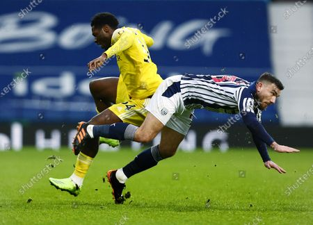 Ola Aina of Fulham and Robert Snodgrass of West Bromwich Albion