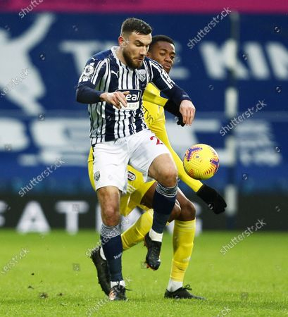 Tosin Adarabioyo of Fulham and Robert Snodgrass of West Bromwich Albion