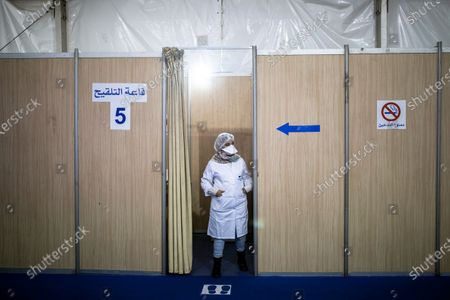 Nurse waits inside a vaccination booth before administering doses of the AstraZeneca-Oxford COVID-19 vaccine to health workers, on the first day of vaccination campaign, in Rabat, Morocco, . Morocco's King Mohammed VI received a shot against the coronavirus Thursday to officially kick off his country's COVID-19 vaccination campaign, which initially will primarily target health care workers, security forces and people over age 75, according to Moroccan authorities