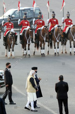 Indian Prime Minister Narendra Modi (C) and Indian President Ram Nath Kovind (C hidden) arrive to attend the annual Beating Retreat military ceremony at Rajpath, in New Delhi, India, 29 January 2021. Beating Retreat is a tradition in which military bands perform during the closing of Republic Day celebrations.