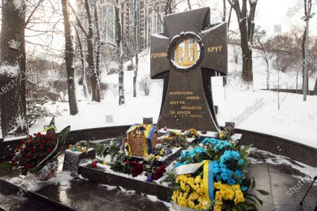Flowers lay at the memorial cross to the Kruty Heroes in Askold's Grave Park on the Kruty Heroes Remembrance Day, Kyiv, capital of Ukraine. On this day, the country pays tribute to almost 400 soldiers of the Ukrainian People's Republic, mostly students, who sacrificed their lives to stop the advance of the Bolshevik Red Army forces of about 4,000 men commanded by Mikhail Muravyov near the Kruty railway station, 130 kilometres north-east of Kyiv, on January 29, 1918.