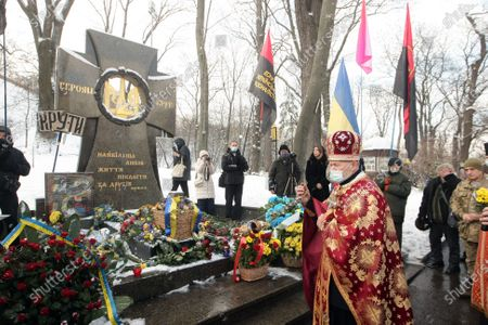 A priest is pictured before the memorial cross to the Kruty Heroes in Askold's Grave Park on the Kruty Heroes Remembrance Day, Kyiv, capital of Ukraine. On this day, the country pays tribute to almost 400 soldiers of the Ukrainian People's Republic, mostly students, who sacrificed their lives to stop the advance of the Bolshevik Red Army forces of about 4,000 men commanded by Mikhail Muravyov near the Kruty railway station, 130 kilometres north-east of Kyiv, on January 29, 1918.