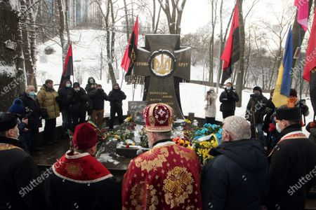 Priests visit the memorial cross to the Kruty Heroes in Askold's Grave Park on the Kruty Heroes Remembrance Day, Kyiv, capital of Ukraine. On this day, the country pays tribute to almost 400 soldiers of the Ukrainian People's Republic, mostly students, who sacrificed their lives to stop the advance of the Bolshevik Red Army forces of about 4,000 men commanded by Mikhail Muravyov near the Kruty railway station, 130 kilometres north-east of Kyiv, on January 29, 1918.