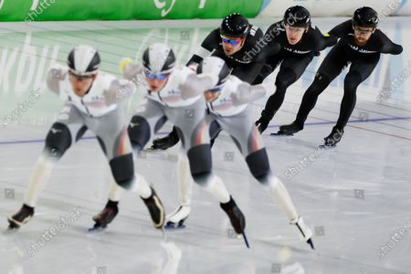 Stock Picture of Team New Zealand, rear, with Peter Michael, front, Josh White, and Kierryn Hughes, rear, is close to lapping Team Germany with Lukas Mann, front, Noel Muller, rear, and Stefan Emele, center, during the men's team pursuit race of the World Cup Speedskating at the Thialf ice arena in Heerenveen, northern Netherlands