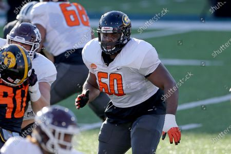Offensive lineman David Moore of Grambling State (FCS) (60) pass protects during the American team practice for the NCAA college football Senior Bowl in Mobile, Ala