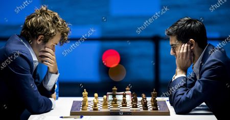 Magnus Carlsen (L) and Anish Giri during the eleventh round of the Tata Steel Chess Tournament in village house De Moriaan in Wijk aan Zee, the Netherlands, 29 January  2021.