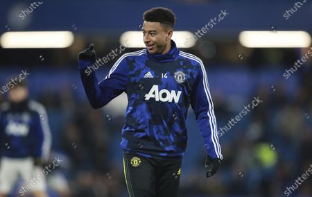 Manchester United's Jesse Lingard gestures during warmup before their English League Cup soccer match against Chelsea at Stamford Bridge in London. Manchester United manager Ole Gunnar Solskjaer on Friday, Jan. 29, 2021 says Jesse Lingard and Marcos Rojo are set to leave the club before the end of the January transfer window. Lingard is moving to fellow Premier League team West Ham on loan until the end of the season