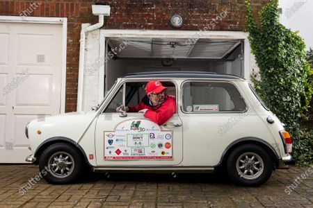 Freddie St George MBE, co-founder of the annual road trip event 'The Italian Job' where he and hundreds of other Mini Cooper fanatics undertake a 10-day road trip to Italy whilst raising money for charity, admires his 1974 Innocenti Mini Cooper at his home in Hove, East Sussex as the race has been cancelled for the second consecutive year.  Freddie was recently awarded an MBE for his services to charity after raising just shy of £3 million for local charities since the races inception in 1990, which the race was cancelled for the first time in its 30 year history last year due to the coronavirus pandemic.   However Freddie is hoping to undertake a localised adaption of the race, 'Mile of Minis' later this year starting in Oxford and finishing in Windsor, raising funds for Buttle UK, lockdown regulations permitting.