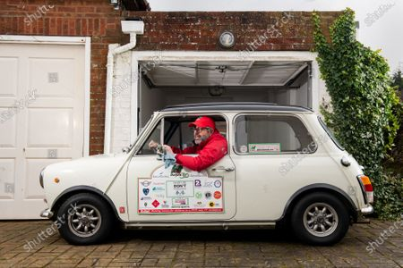 Stock Image of Freddie St George MBE, co-founder of the annual road trip event 'The Italian Job' where he and hundreds of other Mini Cooper fanatics undertake a 10-day road trip to Italy whilst raising money for charity, polishes his 1974 Innocenti Mini Cooper at his home in Hove, East Sussex as the race has been cancelled for the second consecutive year.  Freddie was recently awarded an MBE for his services to charity after raising just shy of £3 million for local charities since the races inception in 1990, which the race was cancelled for the first time in its 30 year history last year due to the coronavirus pandemic.   However Freddie is hoping to undertake a localised adaption of the race, 'Mile of Minis' later this year starting in Oxford and finishing in Windsor, raising funds for Buttle UK, lockdown regulations permitting.