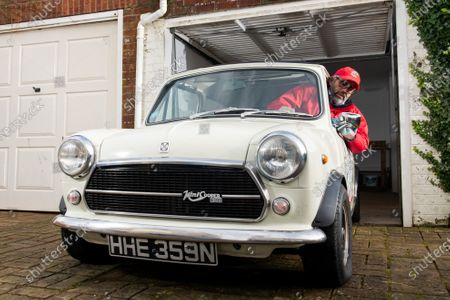 Stock Photo of Freddie St George MBE, co-founder of the annual road trip event 'The Italian Job' where he and hundreds of other Mini Cooper fanatics undertake a 10-day road trip to Italy whilst raising money for charity, polishes his 1974 Innocenti Mini Cooper at his home in Hove, East Sussex as the race has been cancelled for the second consecutive year.  Freddie was recently awarded an MBE for his services to charity after raising just shy of £3 million for local charities since the races inception in 1990, which the race was cancelled for the first time in its 30 year history last year due to the coronavirus pandemic.   However Freddie is hoping to undertake a localised adaption of the race, 'Mile of Minis' later this year starting in Oxford and finishing in Windsor, raising funds for Buttle UK, lockdown regulations permitting.