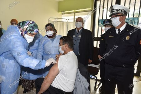 A nurse vaccinates a Police officer against the Covid-19 coronavirus in Sale, Morocco, 29 January 2021. On January 28, Morocco began a vaccination campaign against Covid-19, as King Mohammed VI received the first dose after receiving shipments of the AstraZeneca-Oxford and China Sinopharm vaccines. The vaccination campaign in the first phase is expected to target health care workers and elderly people over the age of 75.