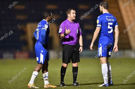 The referee talking to Colchester United's Thomas Smith (5) during the EFL Sky Bet League 2 match between Colchester United and Scunthorpe United at the JobServe Community Stadium, Colchester