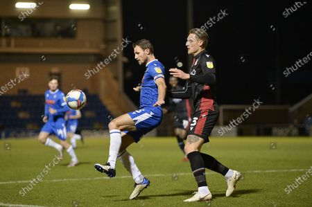 Colchester United's Thomas Smith (5) controls the ball challenged by George Taft (3) of Scunthorpe United during the EFL Sky Bet League 2 match between Colchester United and Scunthorpe United at the JobServe Community Stadium, Colchester