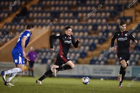Ryan Loft (9) of Scunthorpe United gets away from Colchester United's Thomas Smith (5) during the EFL Sky Bet League 2 match between Colchester United and Scunthorpe United at the JobServe Community Stadium, Colchester