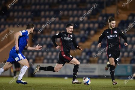 Stock Picture of Ryan Loft (9) of Scunthorpe United gets away from Colchester United's Thomas Smith (5) during the EFL Sky Bet League 2 match between Colchester United and Scunthorpe United at the JobServe Community Stadium, Colchester