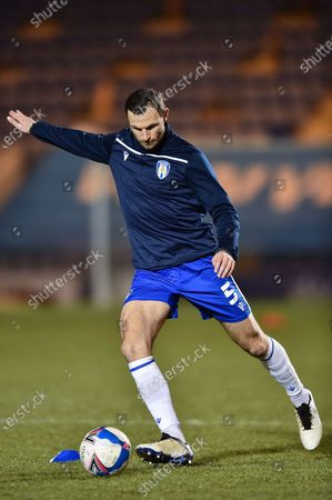 Colchester United's Thomas Smith (5) warm up during the EFL Sky Bet League 2 match between Colchester United and Scunthorpe United at the JobServe Community Stadium, Colchester