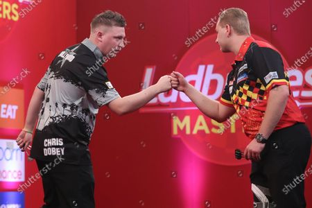 Chris Dobey beats Dimitri van den Bergh in the first round during the PDC Ladbrokes Masters 2021 at Marshall Arena, Milton Keynes