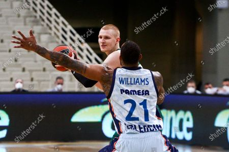 Aaron White (L) of Panathinaikos competes with Derrick Williams of Valencia during the Eurolague basketball match between Panathinaikos OPAP Athens and Valencia Basket at the OAKA Stadium in Athens, Greece, 29 January 2021.
