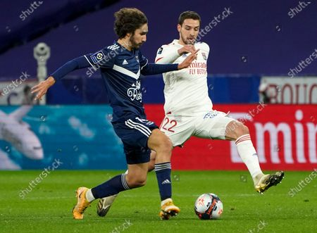 Bordeaux's Yacine Adli, left, and Lyon's Mattia De Sciglio compete for the ball during the French League One soccer match between Lyon and Bordeaux in Lyon, France