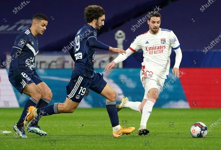 Bordeaux's Hatem Ben Arfa, left, and teammate Yacine Adli, centre, compete against Lyon's Mattia De Sciglio, right, for the ball during the French League One soccer match between Lyon and Bordeaux in Lyon, France