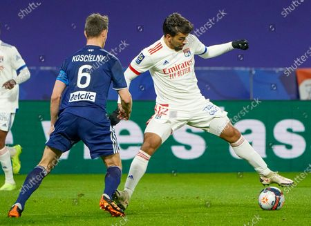 Lyon's Lucas Paqueta, right, and Bordeaux's Laurent Koscielny battle for the ball during the French League One soccer match between Lyon and Bordeaux in Lyon, France