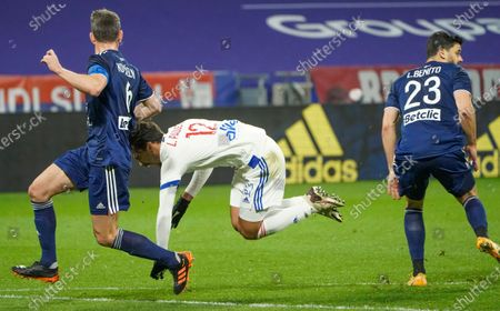 Stock Photo of Lyon's Lucas Paqueta, centre, reacts as he battles for the ball with Bordeaux's Laurent Koscielny, left, and Loris Benito, right, during the French League One soccer match between Lyon and Bordeaux in Lyon, France