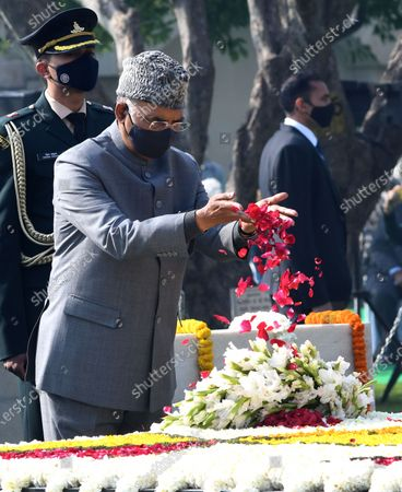 Indian President Ram Nath Kovind pays tribute during an event held to mark the annual Martyrs' Day at the Raj Ghat Mahatma Gandhi memorial, in New Delhi, India, 30 January 2021. The event marks the assassination of the 'Father of the Nation' Mahatma Gandhi, who was killed on 30 January 1948.