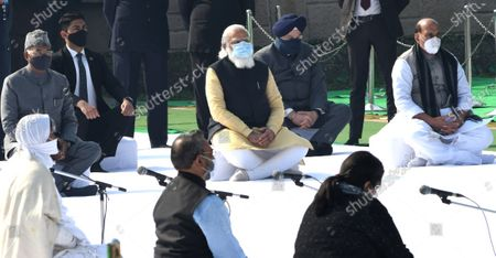 Indian Prime Minister Narendra Modi (C), Defence Minister Rajnath Singh (R) and Indian President Ram Nath Kovind (L) pay tribute during an event held to mark the annual Martyrs' Day at the Raj Ghat Mahatma Gandhi memorial, in New Delhi, India, 30 January 2021. The event marks the assassination of the 'Father of the Nation' Mahatma Gandhi, who was killed on 30 January 1948.