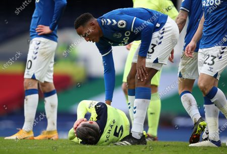 Yerry Mina (R) of Everton checks on Fabian Schar (L) of Newcastle during the English Premier League soccer match between Everton FC and Newcastle United in Liverpool, Britain, 30 January 2021.