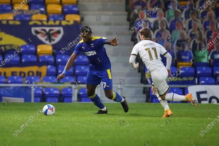 AFC Wimbledon defender Darnell Johnson (27) battles for possession with Milton Keynes Dons attacker Charlie Brown (11) during the EFL Sky Bet League 1 match between AFC Wimbledon and Milton Keynes Dons at Plough Lane, London