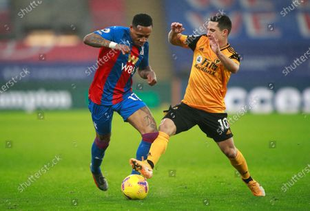 Crystal Palace's Nathaniel Clyne, left, and Wolverhampton Wanderers' Daniel Podence challenge for the ball during the English Premier League soccer match between Crystal Palace and Wolverhampton Wanderers at Selhurst Park stadium in London, England