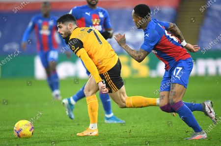 Wolverhampton Wanderers' Pedro Neto, left, and Crystal Palace's Nathaniel Clyne challenge for the ball during the English Premier League soccer match between Crystal Palace and Wolverhampton Wanderers at Selhurst Park stadium in London, England