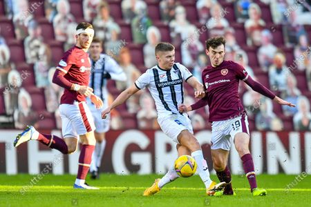 Fraser Murray (#21) of Dunfermline Athletic FC tackles Andy Irving (#19) of Heart of Midlothian FC during the SPFL Championship match between Heart of Midlothian and Dunfermline Athletic at Tynecastle Park, Edinburgh
