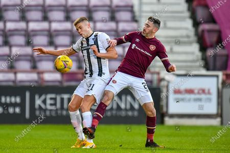 Michael Smith (#2) of Heart of Midlothian FC tackles Fraser Murray (#21) of Dunfermline Athletic FC during the SPFL Championship match between Heart of Midlothian and Dunfermline Athletic at Tynecastle Park, Edinburgh