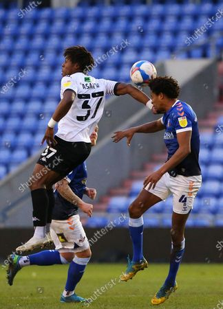 Salford City forward Brandon Thomas-Asante (37) out jumps Oldham Athletic defender Sido Jombati (4)  during the EFL Sky Bet League 2 match between Oldham Athletic and Salford City at Boundary Park, Oldham