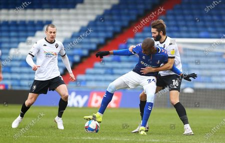 Oldham Athletic midfielder Dylan Bahamboula (24)is marked closely by Salford City defender Jordan Turnbull (16)  during the EFL Sky Bet League 2 match between Oldham Athletic and Salford City at Boundary Park, Oldham