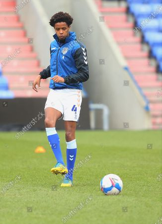 Oldham Athletic defender Sido Jombati (4) warms up   during the EFL Sky Bet League 2 match between Oldham Athletic and Salford City at Boundary Park, Oldham