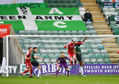 Accrington Stanley defender Mark Hughes (3) heads the ball away during the EFL Sky Bet League 1 match between Plymouth Argyle and Accrington Stanley at Home Park, Plymouth