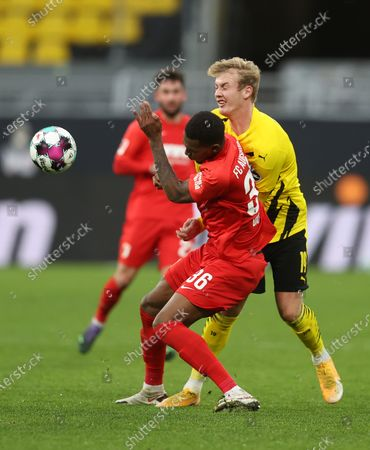 Reece Oxford of FC Augsburg battles for possession with Julian Brandt of Borussia Dortmund (R) during the Bundesliga match between Borussia Dortmund and FC Augsburg at Signal Iduna Park in Dortmund, Germany, 30 January 2021.